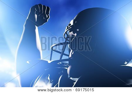 American football player celebrating score and victory. Night stadium lights