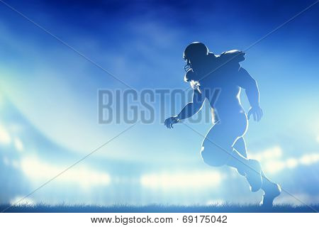 American football player in game, running. Night stadium lights