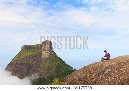 Man Sitting On Edge Of Mountain Pedra Bonita, Pedra Da Gavea, Rio De Janeiro