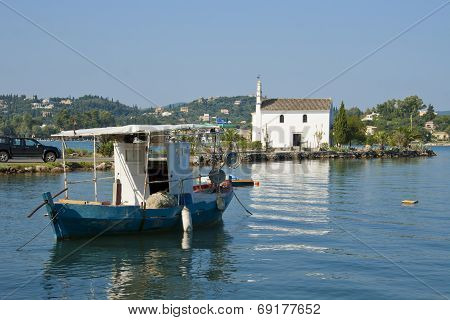 Church and boat in Gouvia, Corfu