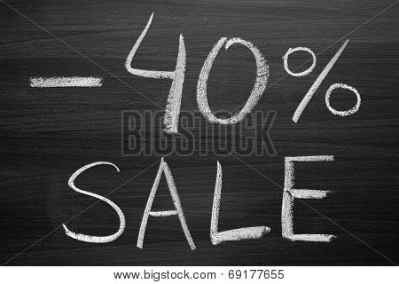 40-percent sale title written with a chalk on the blackboard