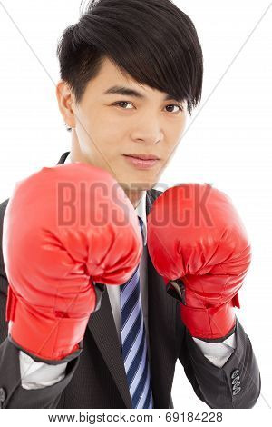 Business Man Sneer  And Ready To Fight With Boxing Gloves