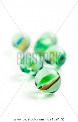 Glass marble balls on white background
