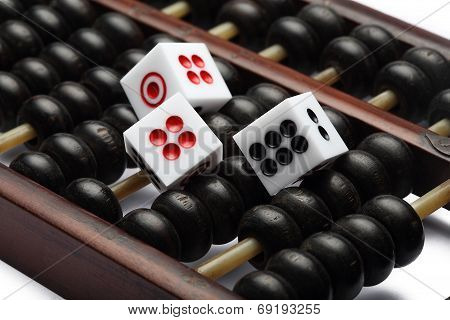 three dice on abacus are symbolic of gambling