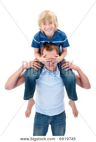 Cheerful Father Giving His Son Piggyback Ride