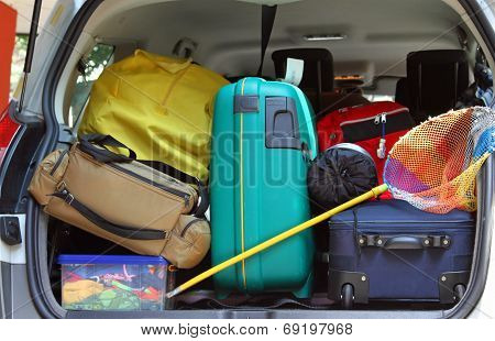 Bag And Trolley With A Fishing Net In The Trunk Of The Car