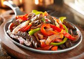 stock photo of red meat  - steamy hot mexican beef fajitas - JPG