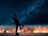 stock photo of city silhouette  - Silhouette of Asian couple - JPG