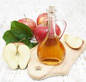 picture of cider apples  - Apple cider vinegar and fresh apple on a wooden background - JPG