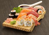 stock photo of sushi  - japanese seafood sushi and maki on wooden plate - JPG