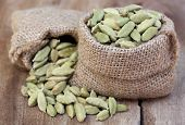 picture of cardamom  - Close up of Cardamom seed in sack - JPG
