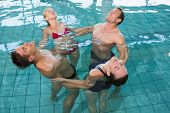 pic of day care center  - Happy fitness class stretching in aqua aerobics in swimming pool at the leisure centre - JPG