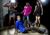 image of peer-pressure  - Caucasian man falls but confidently plays cool in a dance club - JPG