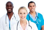 stock photo of male female  - Portrait Of Enthusiastic Medical Team against a white background - JPG