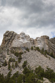 stock photo of mount rushmore national memorial  - view of Mount Rushmore National Monument on a spring morning with some clouds and sunshine - JPG