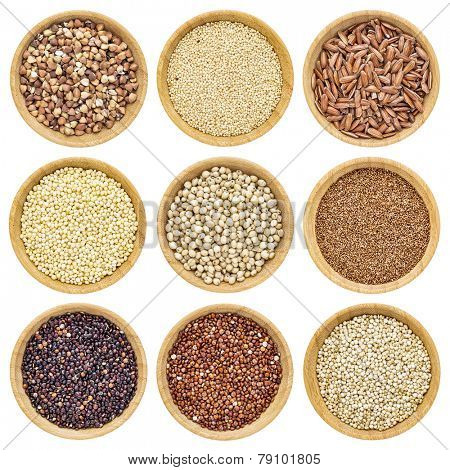 gluten free grains  - buckwheat, amaranth, brown rice, millet, sorghum, teff, black, red and white quinoa - isolated wooden bowls