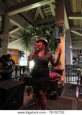 Female Singer From Guidance Band Sings On Stage At Mai Tai Bar