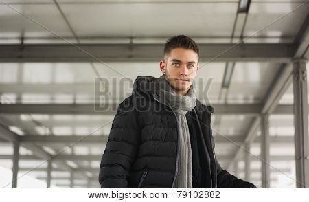 Attractive young man under tunnel in urban environment
