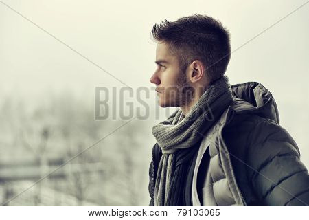 Handsome young man outdoor in winter