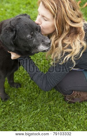 girl kissing senior dog