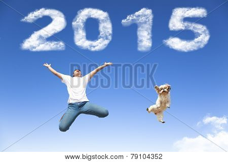 Happy New Year 2015.young Man And Dog  Jumping Together