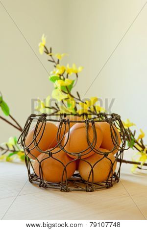 Brown Eggs In A Wire Basket