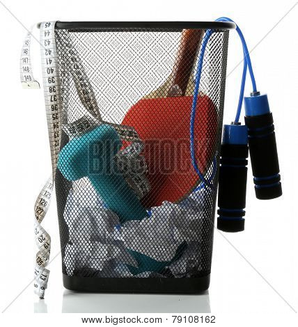 Metal trash bin with sport equipment, crumpled paper and weight scale isolated on white