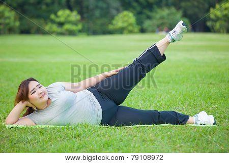 Fat Woman Lying By Exercise Leg Upwards