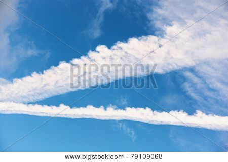 Traces Of Planes In The Blue Sky