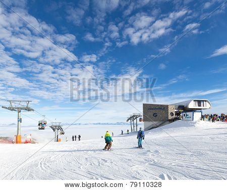 People Skiing And Snowboarding