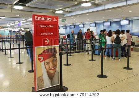 GENEVA - SEP 16: Emirates check-in area on September 16, 2014 in Geneva, Switzerland. Emirates is the flag carrier of the United Arab Emirates along with Etihad Airways and is based in Dubai