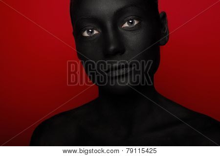 close-up portrait of woman in black paint
