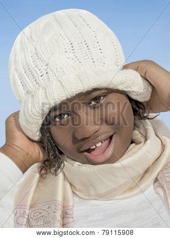 Girl smiling under the winter sun