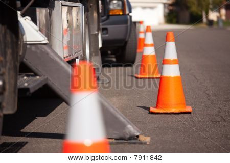 Orange Hazard Cones And Utility Truck In Street