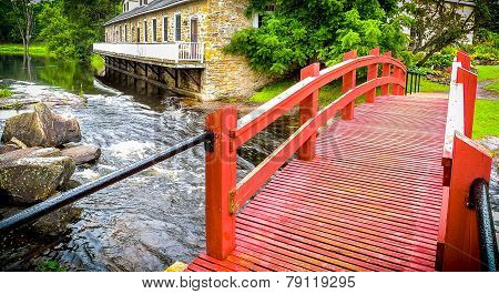 Red footbridge in the park.