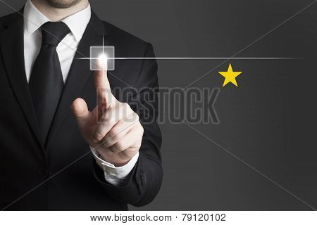 Businessman Pushing Button Single Gold Star