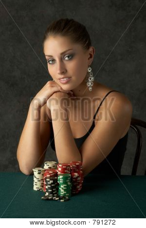 Beautful Young Woman Sitting with Poker Chips