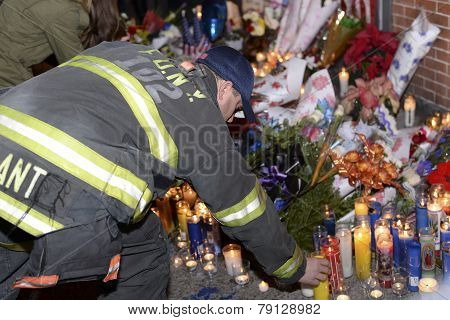 FDNY firefighter lights candle