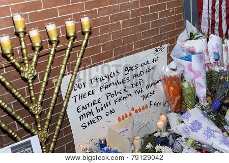 Menorah & hand-letter sign at memorial