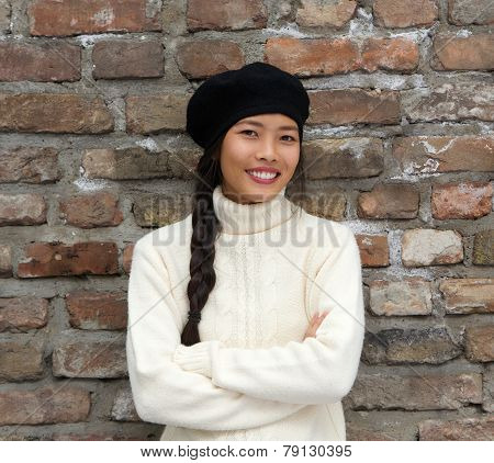 Smiling Young Woman Wearing Beret Hat