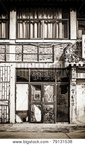a broken shop in a street of shanghai