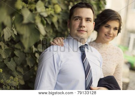 Young newlywed couple looking away