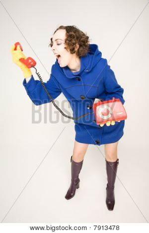 Girl In Blue Coat Screaming In Handset