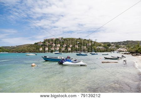 Boats And Jet Skis By Resort Beach