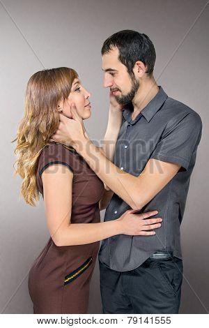 Embracing Couple In Love Posing At Studio