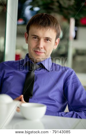 Modern hipster businessman drinking espresso coffee in the city cafe during lunch time