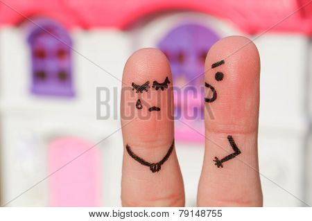 Finger art of a couple during quarrel. A man yells at a woman. Woman crying.