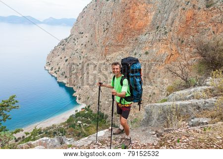 Sportsman on the top of rock. Sport and active life concept