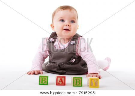 Baby Girl Posing with Blocks