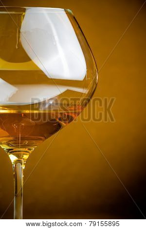 White Wine Into A Glass With Space For Text, Warm Atmosphere